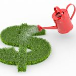 watering can pouring water over dollar sign made of grass
